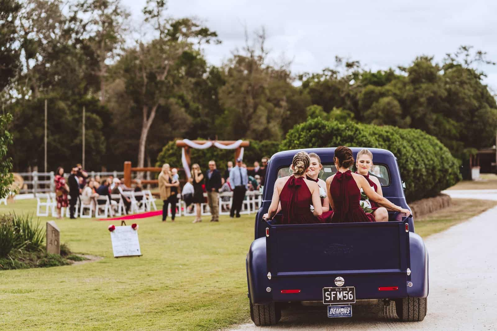 Bridal party arrive in a truck